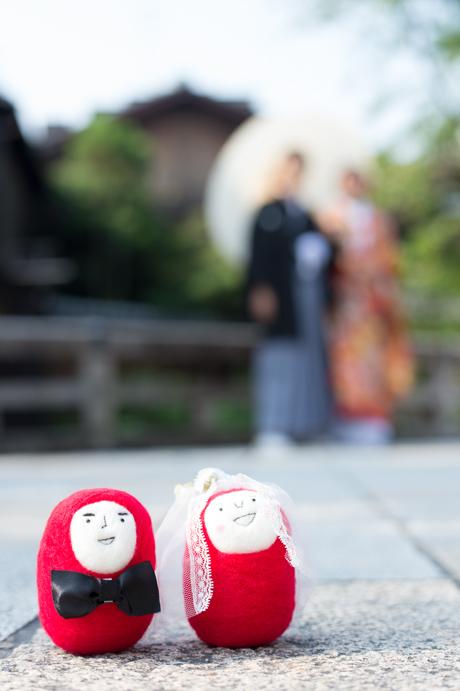 ダルマの人形と写真